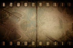 Grunge old motion picture reel with film strip Stock Photography