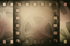 Grunge old motion picture reel with film strip Stock Images