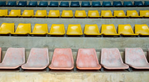 Grunge Old Multi Color Seat in The Stadium Background Texture Royalty Free Stock Photo