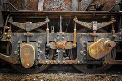 Grunge old steam locomotive wheels close up. Grunge old steam locomotive wheels Royalty Free Stock Photography