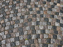 Grunge old stone cobbles as a background Stock Images
