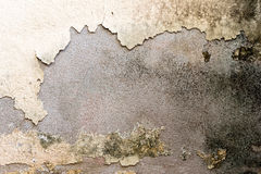 Grunge old yellow paint cement wall Royalty Free Stock Photo