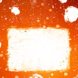 Grunge orange banner with white inky splashes Stock Image