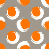 Grunge orange and white circles on a light grey background Royalty Free Stock Images