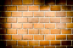 Grunge oranje bakstenen muur, donkere toon Royalty-vrije Stock Fotografie