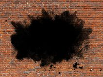 Grunge Paint on Brick wall. Grunge copyspace of black paint strokes and spatter on a brick wall Stock Images