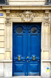 Grunge painted Art Deco door. With bronze handles in Paris Stock Photo