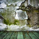 Grunge painted cracked wall and wooden floor Stock Photos