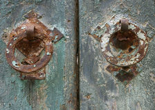 Grunge painted door details. With rusty metal handle Royalty Free Stock Photography