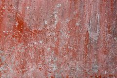 Grunge painted wall in dark red flake with crack texture of stai. Grunge painted wall in dark red flake background with crack texture of stains and scale Stock Photo
