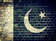 Grunge Pakistan flaga na ściana z cegieł Fotografia Stock