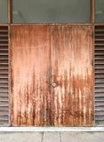 Grunge and pale wooden door. Architecture concept Stock Photos