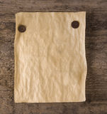 Grunge paper. On wood background Royalty Free Stock Photography