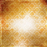 Grunge paper background with damask pattern. Royalty Free Stock Images
