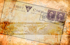 Grunge paper background and old postcard. Royalty Free Stock Images