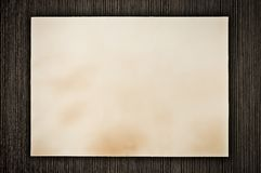 Grunge paper background on wood Royalty Free Stock Photos