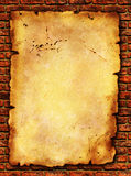 Grunge paper on brick wall texture stock photography