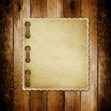 Grunge paper for invitation on the wooden background Royalty Free Stock Photos