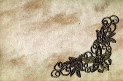 Grunge paper with lace. A piece of grungy old paper overlaid with old lace Stock Photos