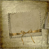 Grunge paper with ribbon and bow Stock Photos