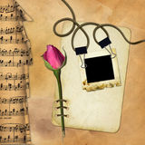 Grunge paper with rose on musical background Royalty Free Stock Photography