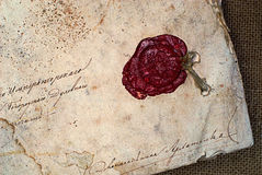 Grunge paper with sealing wax. Old grunge paper background with sealing wax stock photography