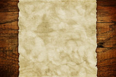 Grunge paper sheet on wooden wall or table in loft style Stock Photo
