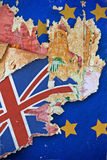 Grunge paper with UK flag on the wallpaper break away from the European Union. Stock Photos