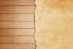 Grunge paper on wooden wall background Stock Image