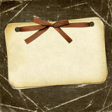 Grunge papers with bow on dark background Royalty Free Stock Photography