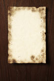 Grunge parchment on wooden board Royalty Free Stock Photo