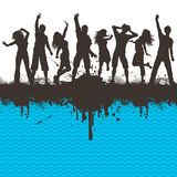 Grunge party. Silhouettes of people dancing on a grunge chevron striped background Royalty Free Stock Image