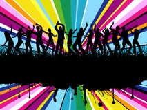 Grunge party time. Silhouettes of people dancing on grunge style colourful background Royalty Free Stock Photography