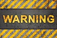 Grunge Pattern with Warning Text. Grunge Black and Orange Pattern with Warning Text, Old Metal Textured Royalty Free Stock Photos