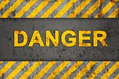 Grunge Pattern with Warning Text (Danger). Grunge Black and Orange Pattern with Warning Text (Danger), Old Metal Textured Royalty Free Stock Image