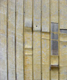 Grunge peeling yellow wood on timber background Stock Photography