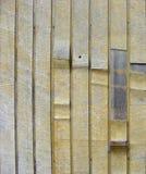 Grunge peeling yellow wood on timber background Stock Photography