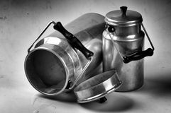 Grunge photo of vintage milk cans Stock Image