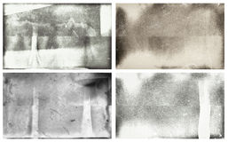 Grunge photographic wet plates. Set of four grunge photographic wet plates with scratches, dusk and finger smudges Royalty Free Stock Photography