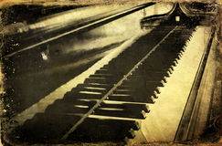 Grunge piano. Musical background and added paper texture Royalty Free Stock Images