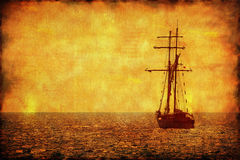 Grunge picture of alone sailing ship Royalty Free Stock Photo