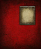 Grunge Picture Frame on red Wall. Background Stock Photography