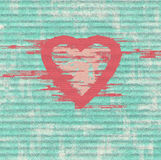 Grunge pink heart on  blue   background Stock Photography