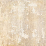 Grunge plaster background. Abstract background of light colored distressed grungy antique plaster wall Stock Image