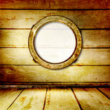 Grunge portholes on the wooden background Royalty Free Stock Photos