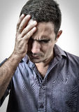 Grunge portrait of a man with a headache Royalty Free Stock Photography