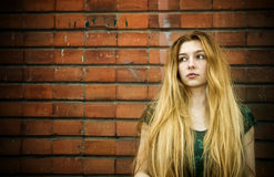 Grunge portrait of sad young woman Stock Photography