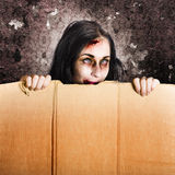 Scary zombie girl advertising halloween price cut Stock Image