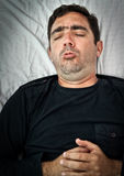 Grunge portrait of a sick hispanic coughing Royalty Free Stock Images