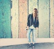 Grunge portrait of woman in blue jeans